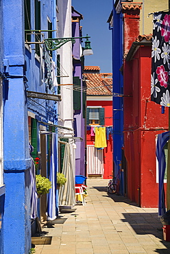Italy, Veneto, Burano Island, A colourful alleyway.