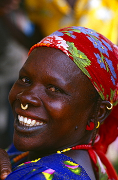MALI  Body Decoration Smiling African woman wearing floral headscarf and small gold nose ring through her septum