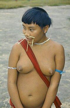 Portrait of Yanomami woman with facial piercings, Amazon, Roraima, Brazil