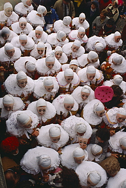 BELGIUM Walloon Region Binche Les Gilles parade in medieval costume at carnival.