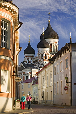 ESTONIA  Tallinn Two women walking through the Toompea district of the Old Town with Alexander Nevsky Cathedral in the background. Baltic States Travel Holidays Tourism