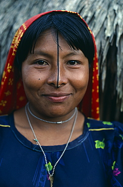 PANAMA San Blas Islands Ustupu Kuna Indians Portrait of smiling Kuna woman with gold nose ring and black line drawn along length of nose thought to enhance beauty. Cuna Caribbean American Central America Female Women Girl Lady Hispanic Latin America Latino Panamanian West Indies