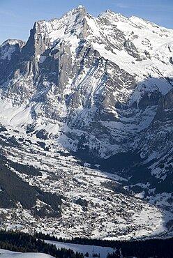 The town of Grindelwald spread out under Wetterhorn Mountain, Grindelwald, Bernese Oberland, Switzerland