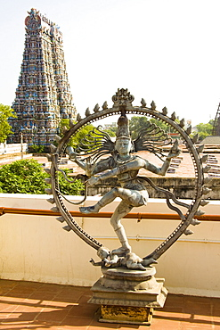 Nataraja, dancing posture of Hindu God Shiva, and a gopuram, Meenakshi Temple, Madurai, Tamil Nadu, India