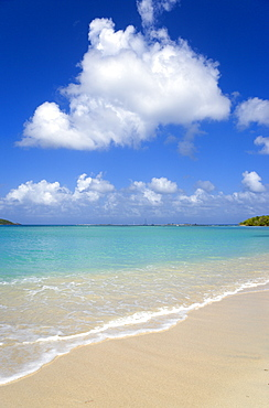 Waves breaking on Paradise Beach at LEsterre Bay with the turqoise sea and Sandy Island sand bar beyond, Grenada