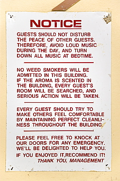 Hillsborough Notice from the management on the wall of a hotel asking that guests not disturb other guests with loud music or the smoking of cannabis weed, Caribbean
