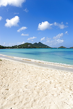 Waves breaking on Paradise Beach at LEsterre Bay with the turqoise sea and The Sister Rocks beyond, Caribbean