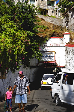 The Sendall Tunnel built in 1894 with pedestrians and cars moving through it, CaribbeanKids