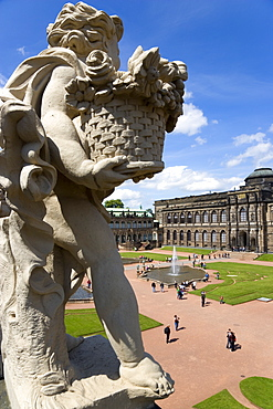 GERMANY, Saxony, Dresden, The central Courtyard and Picture Gallery of the restored Baroque Zwinger Palace gardens busy with tourists seen from the statue lined Rampart originally built between 1710 and 1732 after a design by MatthŠus Daniel Pšppelmann in collaboration with sculptor Balthasar Permoser