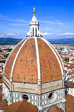ITALY, Tuscany, Florence, The Dome of the Cathedral of Santa Maria del Fiore the Duomo by Brunelleschi with tourists on the viewing platform looking over the city towards the surrounding hills