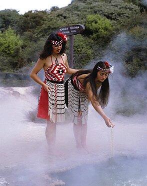New Zealand, North Island, Rotorua Thermal Pools with Maori girls in traditional dress