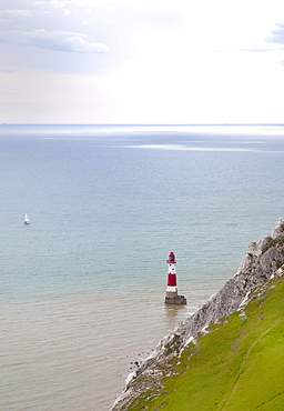 England, East Sussex, Eastbourne, Beachy Head, view of the lighthouse at the base of the chalk cliffs