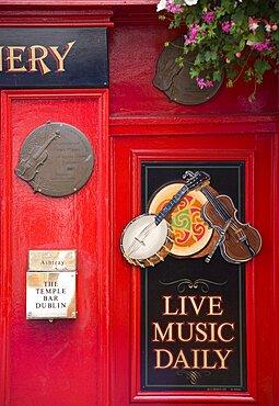 Ireland, County Dublin, Dublin City, Sign on Temple Bar traditioanl Irish pub advertising live music daily.