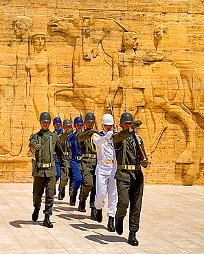 Turkey, Ankara, Anitkabir, Mausoleum of Mustafa Kemal Ataturk founder of the modern Turkish Republic and president in 1923. Changing of the Guard taking place in foreground of relief carved frieze.