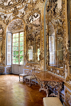 Germany, Bavaria, Munich, Nymphenburg Palace. Amalienburg The Hall of Mirrors. Hunting lodge created for Electress Amalia in European Rococo style. Highly ornate white and gold interior with mirrored walls.