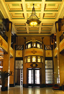 Peace Hotel Interior of foyer with marble floor upper balcony and revolving door at entrance, Shanghai, China