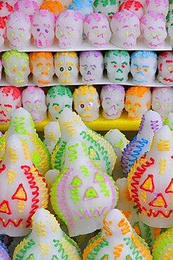 Sugar candies shaped as skulls and lanterns for Dia de los Muertos or Day of the Dead festivities, Puebla, Mexico