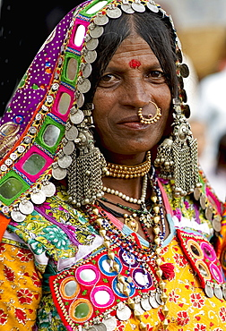 Smiling Lambani Gypsy woman with gold nose ring Tribal forest dwellers now settled in 30-home rural hamlets Related to the Rabaris gypsies of Kutch Gujarat, People, Karnataka, India