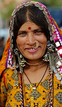 Smiling Lambani Gypsy Tribal woman wearing gold nose ring Forest dwellers now settled in 30-home rural hamlets Related to the Rabaris gypsies of Kutch Gujarat, People, Karnataka, India