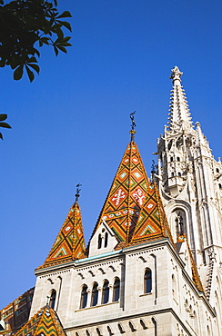 Hungary, Budapest, Buda Castle District, the tiled Bela tower with Matyas Church behind.