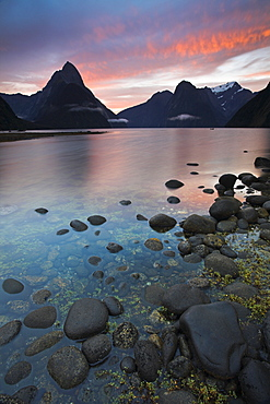 Fiery sky over Milford Sound at dawn, Fiordland National Park, UNESCO World Heritage Site, South Island, New Zealand, Pacific