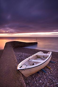 Fishing boat on Sidmouth beach at dawn, Sidmouth, Devon, England, United Kingdom, Europe