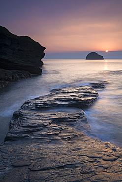 Sunset over Gull Rock from Trebarwith Strand, Cornwall, England, United Kingdom, Europe
