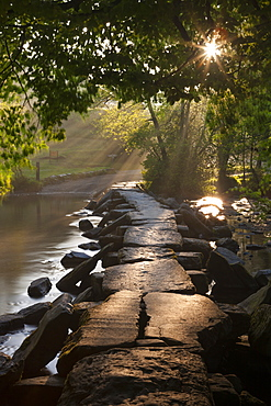 Ancient clapper bridge Tarr Steps spanning the River Barle in Exmoo National Park, Somerset, England, United Kingdom, Europe