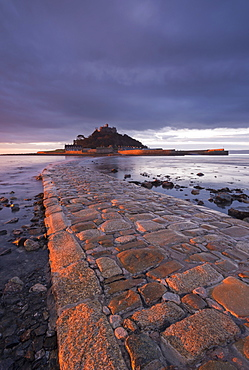 First light of day in winter on the stone causeway leading to St. Michaels Mount, Marazion, Cornwall, England, United Kingdom, Europe