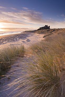 Sunrise over Bamburgh Castle, Northumberland, England, United Kingdom, Europe