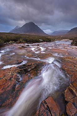 Stream rushing through Rannoch Moor towards the iconic mountain Buachaille Etive Mor, Highland, Scotland, United Kingdom, Europe