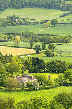 Farmhouse surrounded by rolling Cotswolds countryside, Dursley, Gloucestershire, England, United Kingdom, Europe