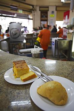 Sopa paraguaya (cornbread with cheese and onion) and empanada in Lido Bar, Asuncion, Paraguay, South America