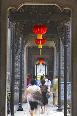 People walking along corridor at Chen Clan Academy, Guangzhou, Guangdong, China, Asia