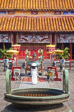 Woman wearing Ao Dai dress at Mieu Temple inside Citadel, Hue, Thua Thien-Hue, Vietnam, Indochina, Southeast Asia, Asia