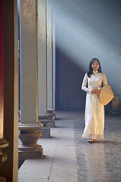 Woman wearing ao dai dress at Thien Hau Pagoda, Cholon, Ho Chi Minh City, Vietnam, Indochina, Southeast Asia, Asia