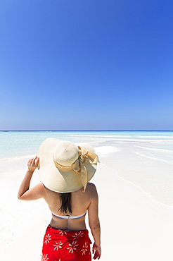 Woman on sandbank, Rasdhoo Island, Northern Ari Atoll, Maldives, Indian Ocean, Asia