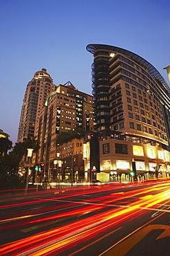 Light trails of traffic passing Da Vinci Hotel, Sandton, Johannesburg, Gauteng, South Africa, Africa