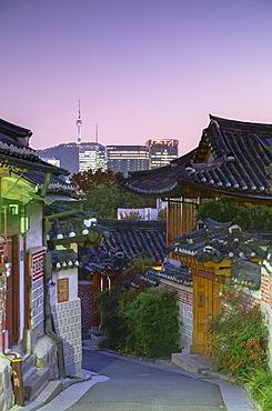 Traditional houses in Bukchon Hanok village and Namsan Seoul Tower at dusk, Seoul, South Korea, Asia