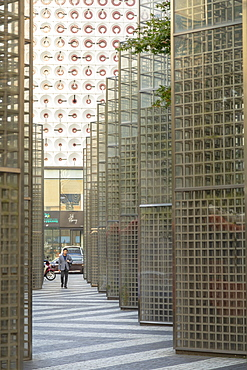 Man walking past modern architecture, Gangnam, Seoul, South Korea, Asia