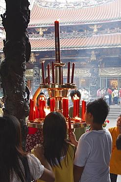 People lighting incense sticks, Longshan Temple, Taipei, Taiwan, Asia