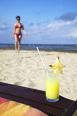 Woman and tropical drink on beach, Sanur, Bali, Indonesia, Southeast Asia, Asia