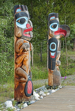 Totem poles with beaver image on the left and eagle image on the right, Tlingit Heritage Center, Teslin, Yukon, Canada, North America