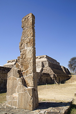 Stela 18 dating from 100 BC to 300 AD in foreground, with Building Group IV, Ceremonial Complex in the background, Monte Alban, UNESCO World Heritage Site, Oaxaca, Mexico, North America