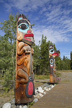 Totem poles with beaver image in the foreground, Teslin Tlingit Heritage Center, Teslin, Yukon, Canada, North America