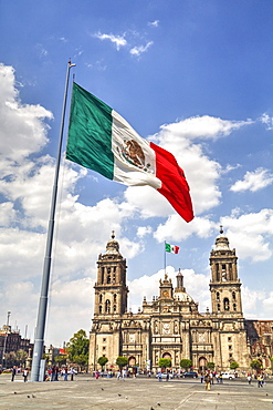Mexican flag, Plaza of the Constitution (Zocalo), Metropolitan Cathedral in background, Mexico City, Mexico D.F., Mexico, North America