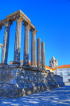 Roman Temple in foreground, Evora Cathdral in the background, Evora, UNESCO World Heritage Site, Portugal, Europe