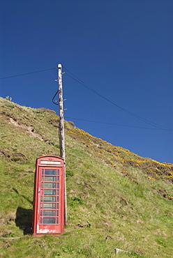 Isolated telephone box, Crovie, Highlands, Scotland, United Kingdom, Europe