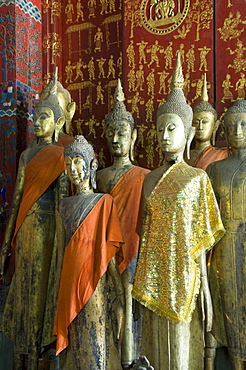 Buddha statues in the Funerary Carriage Hall, Wat Xieng Thong, UNESCO World Heritage Site, Luang Prabang, Laos, Indochina, Southeast Asia, Asia