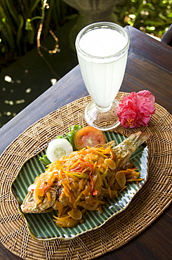 Baked fish Balinese style with a fresh lemon drink, Ubud, Bali, Indonesia, Southeast Asia, Asia